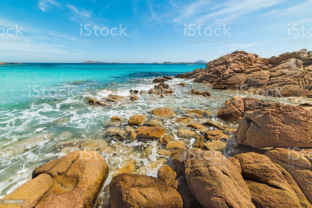 yellow rocks in Capriccioli beach stock photo