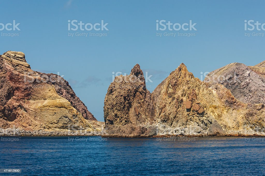 yellow rocks on White Island stock photo
