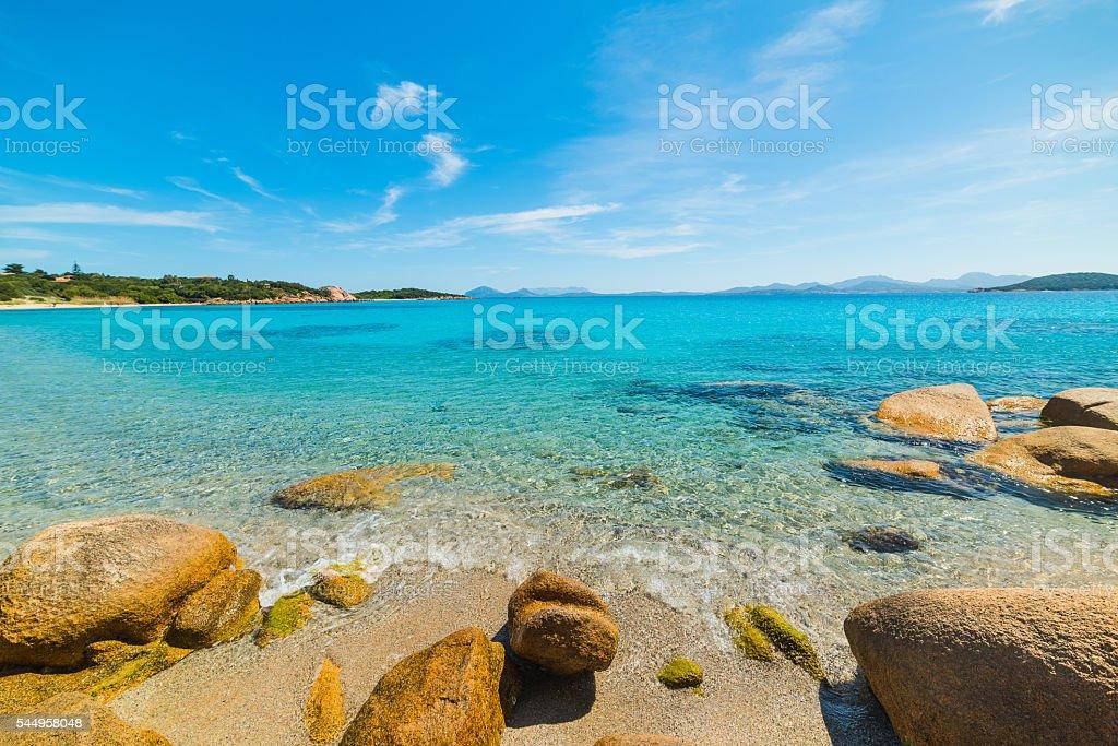 yellow rocks under a blue sky stock photo