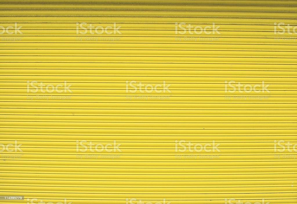 Yellow Roller Shutter Door stock photo