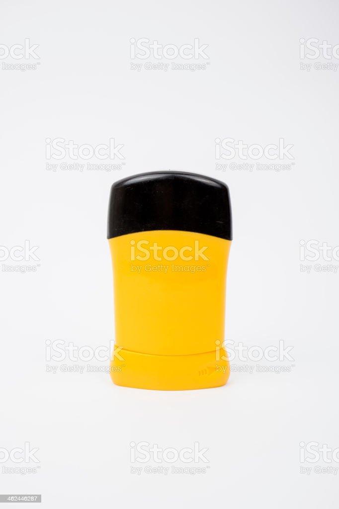 Yellow roll-on deodorant bottle stock photo