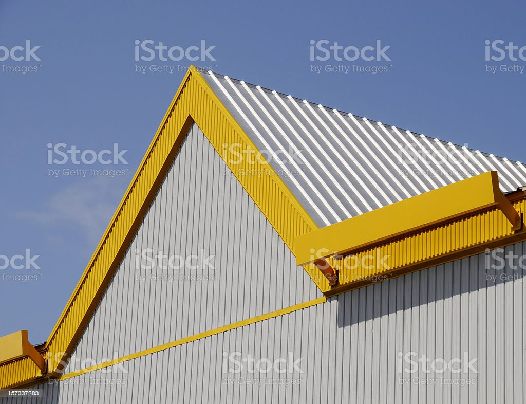 Yellow Roof Peek Building Detail; Don Hutson Center royalty-free stock photo