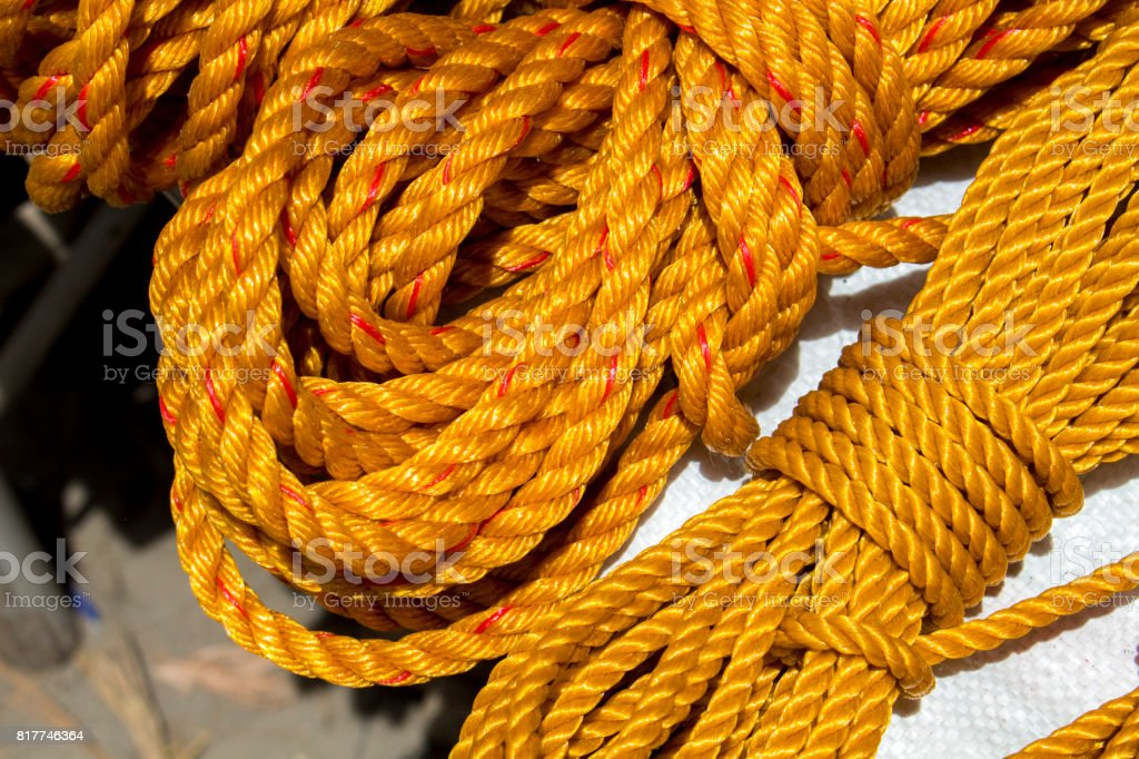 Yellow rope in piles on the market. stock photo