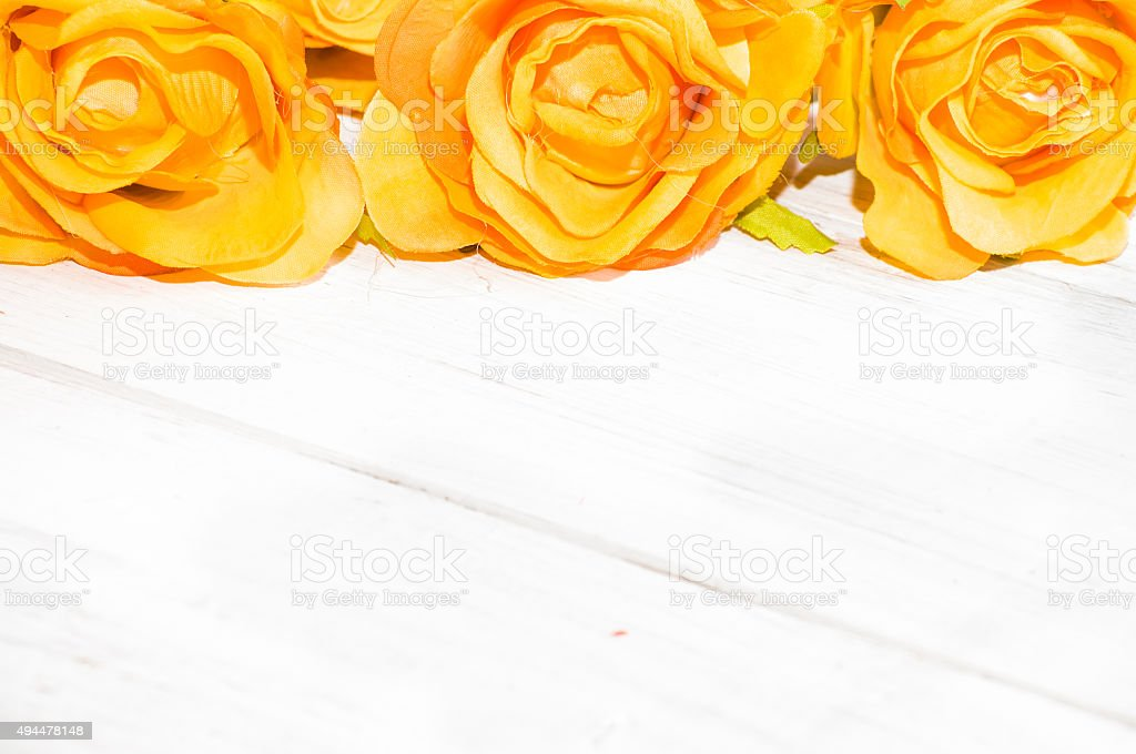 Yellow roses flowers on a white wooden background. Flowers backgrounds. stock photo
