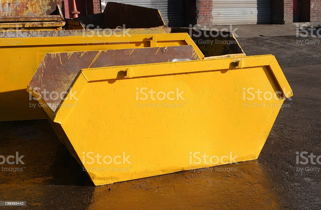 A yellow rubbish skip container royalty-free stock photo