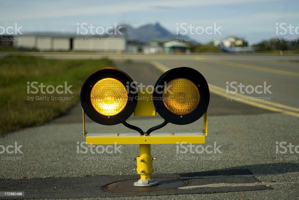 Yellow runway holding lights - left stock photo