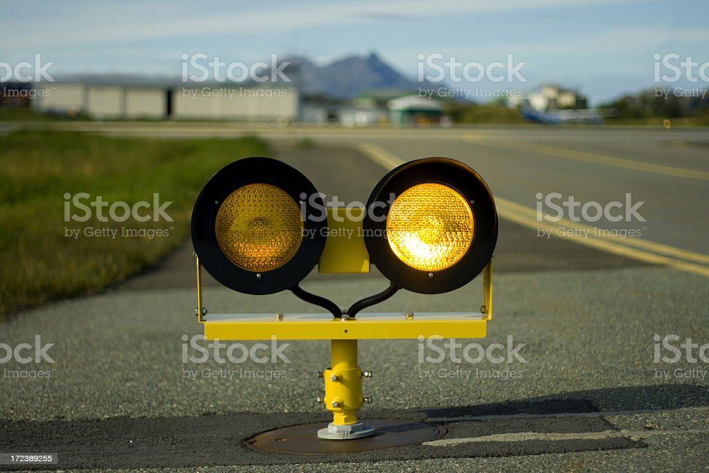 Yellow runway holding lights - right stock photo