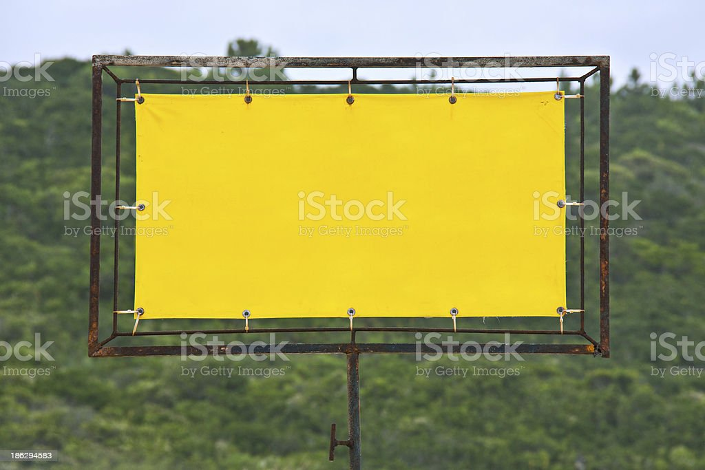 Yellow rusty sign stock photo