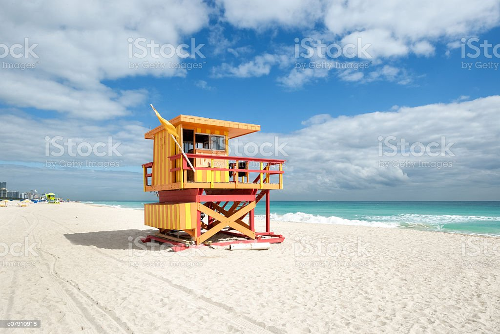 Yellow safeguard cabin on the beach stock photo