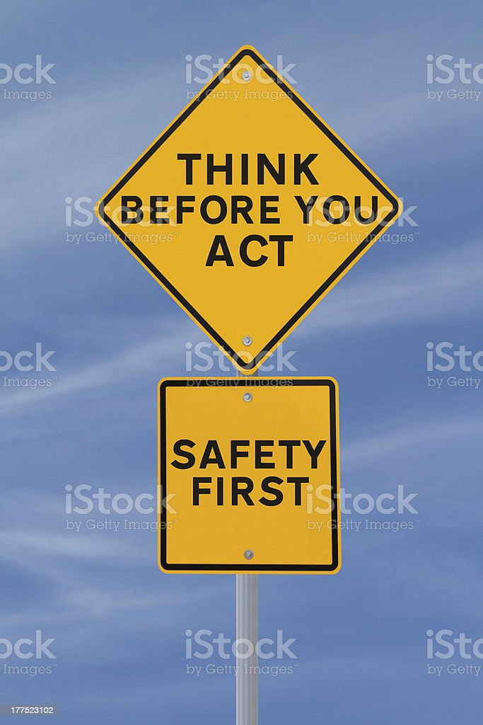 Yellow safety signs against sky background stock photo