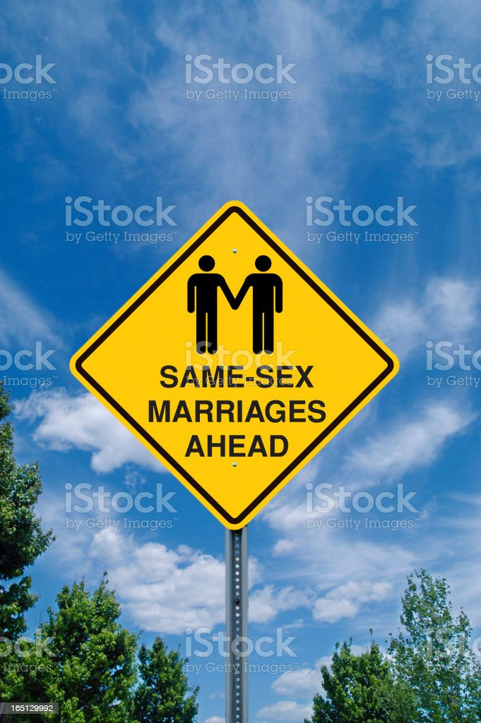 Yellow same sex marriage sign against a blue sky stock photo