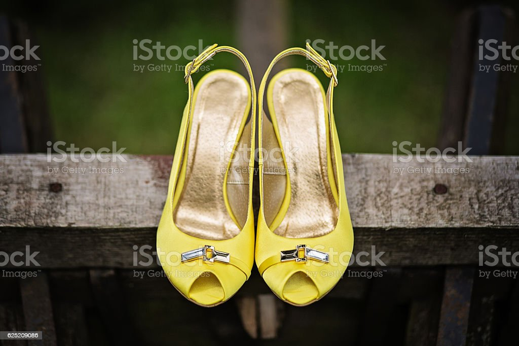 Yellow satin peep toe party wedding sandals stock photo