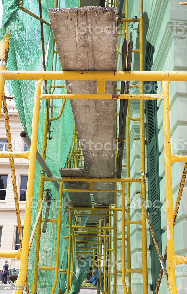 Желтый scaffold на строительной площадке, Стоковые фото Стоковая фотография