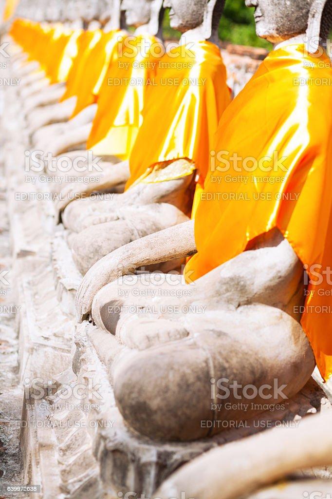 Yellow scarfs on thai buddhas stock photo