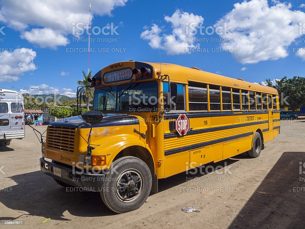 Yellow school bus parked in the Nicaraguan City of Leon stock photo