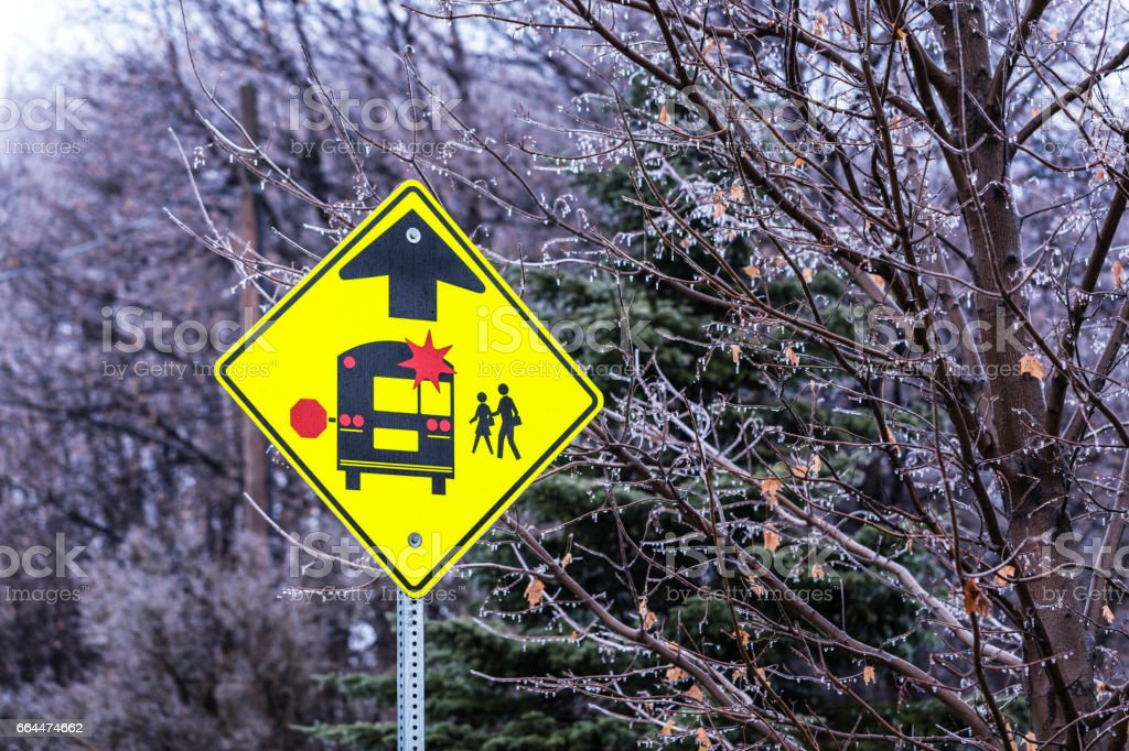 Yellow School Bus Stop Ahead Warning Road Sign stock photo