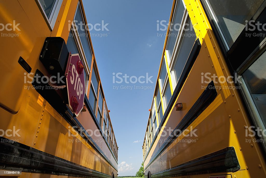 Yellow school bus waiting for students royalty-free stock photo