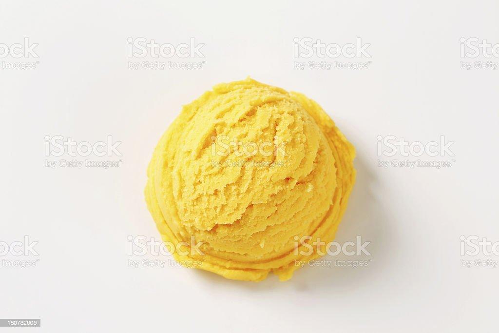 Yellow scoop of ice cream on white background stock photo