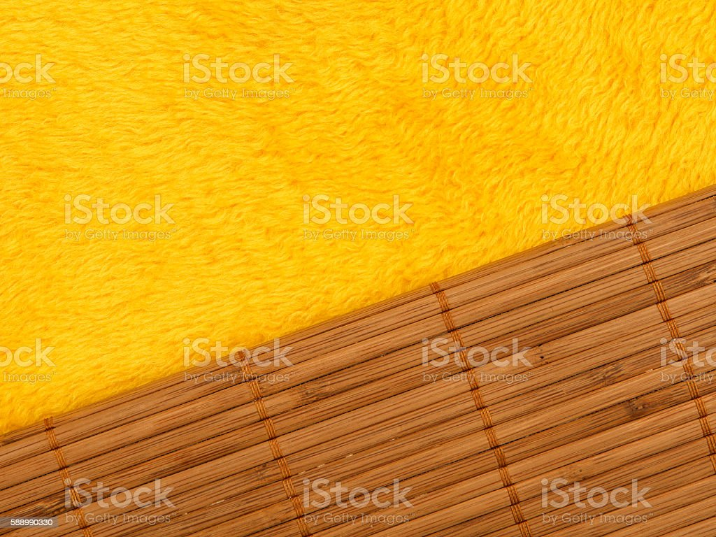 Yellow shag carpet and bamboo stick detail stock photo