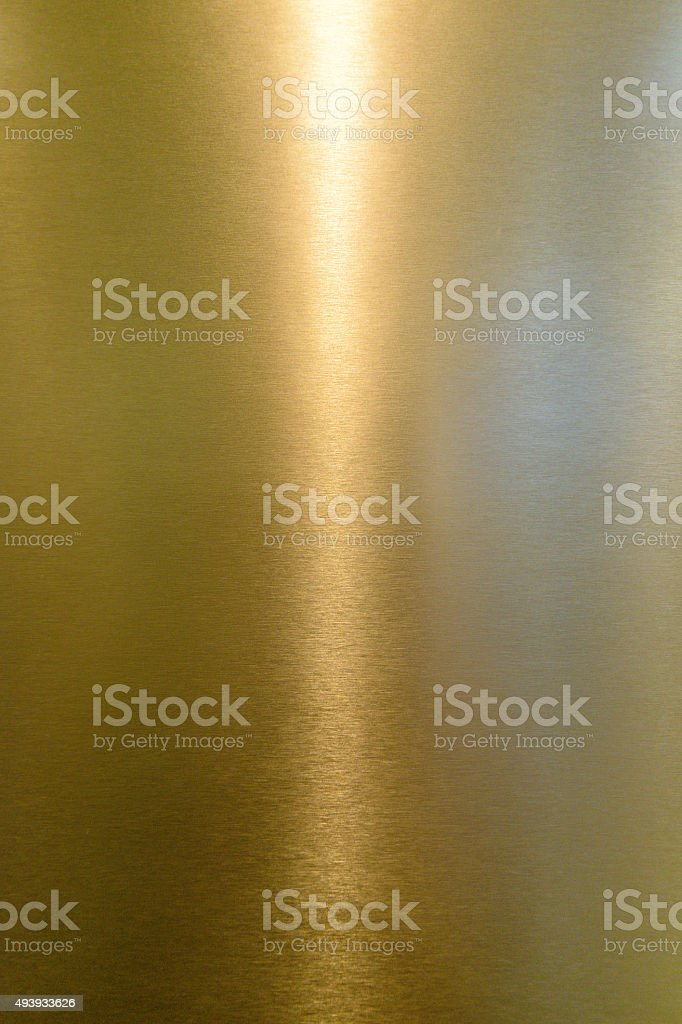 Yellow shiny metal surface stock photo