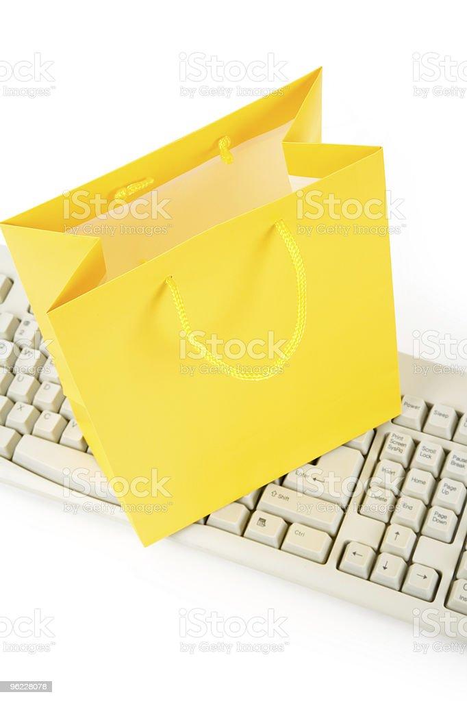Yellow Shopping Bag and Computer Keyboard stock photo
