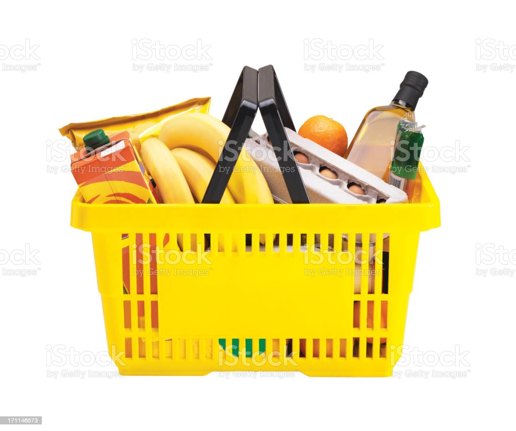 Yellow shopping basket filled with groceries  stock photo