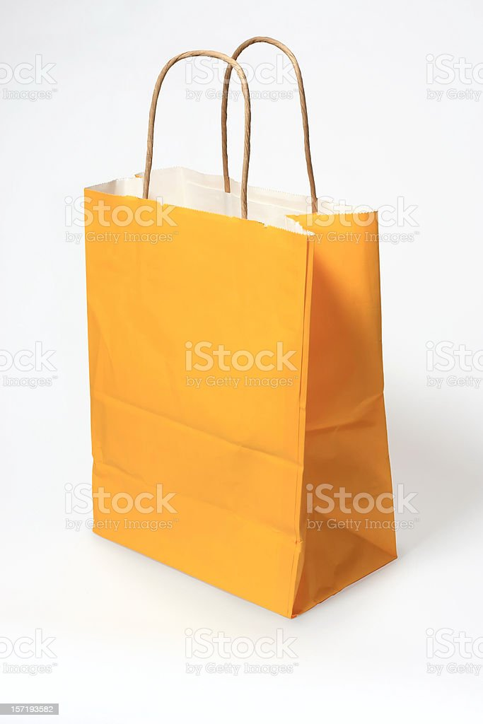 Yellow shopping gift bag  isolated on white royalty-free stock photo