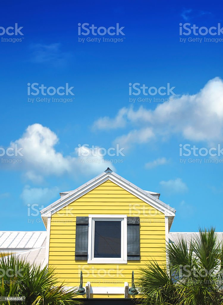yellow siding home over blue sky royalty-free stock photo