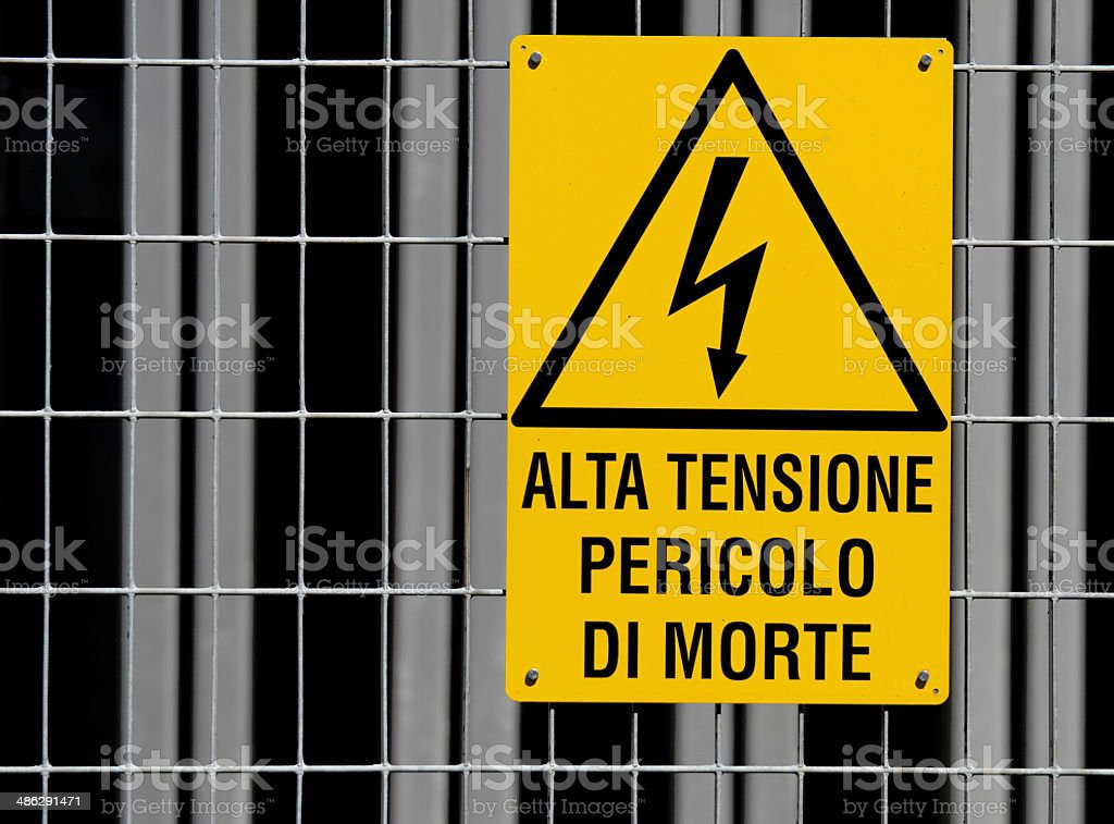 yellow sign for danger high voltage attention stock photo