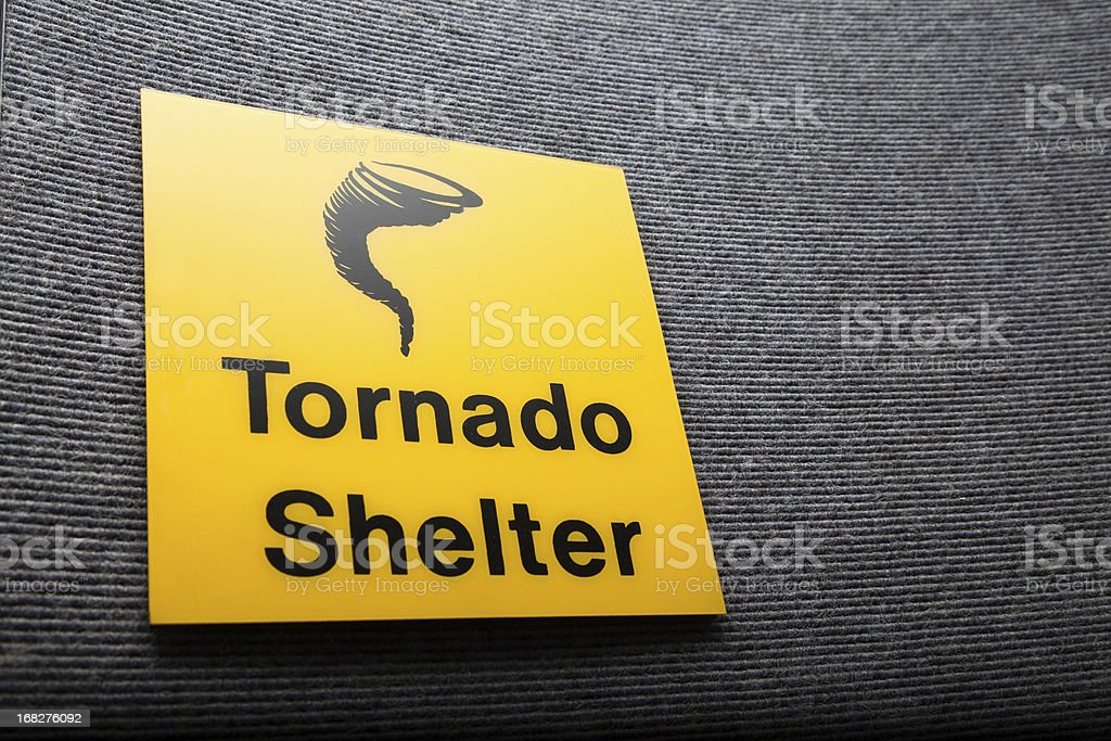 Yellow sign got a tornado shelter on a wall stock photo
