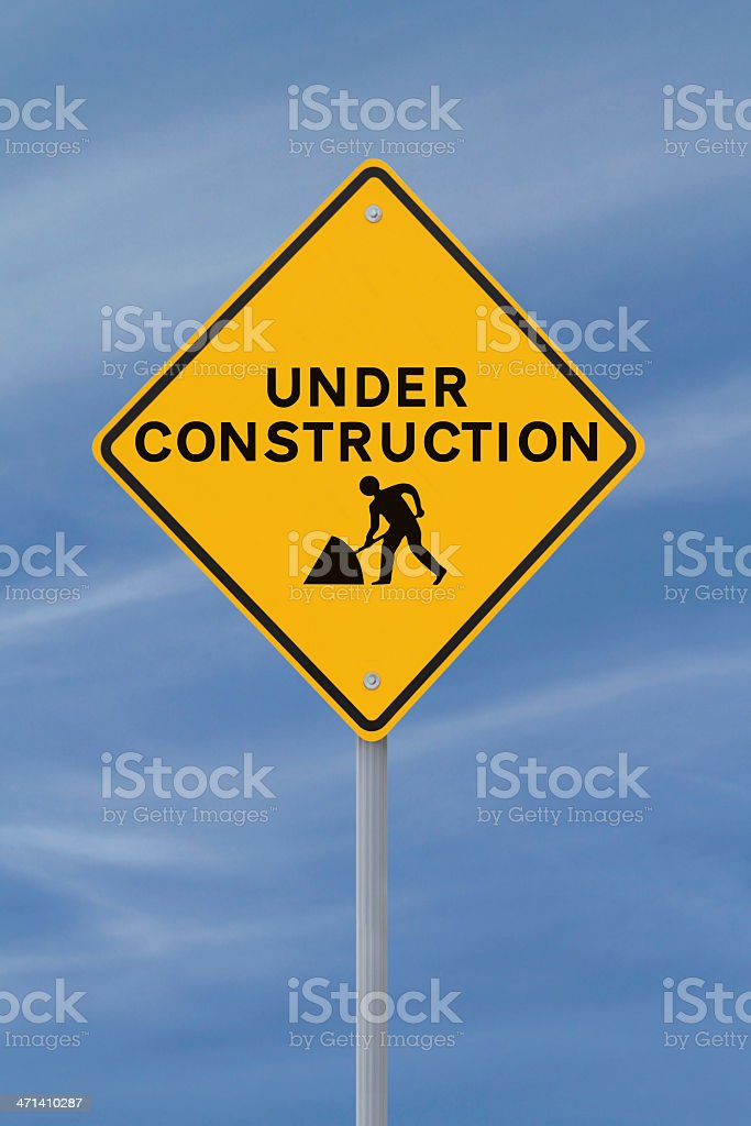 Yellow sign reading under construction stock photo