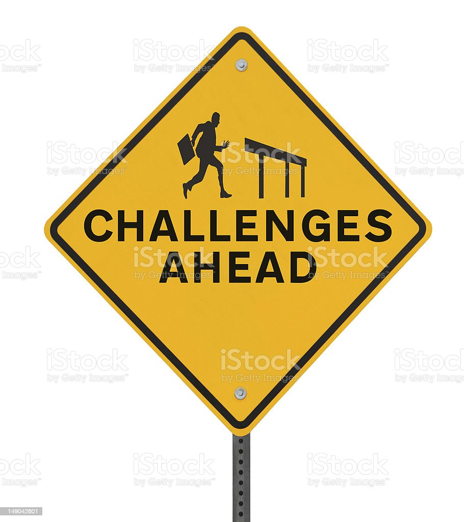 A yellow sign stating challenges ahead stock photo