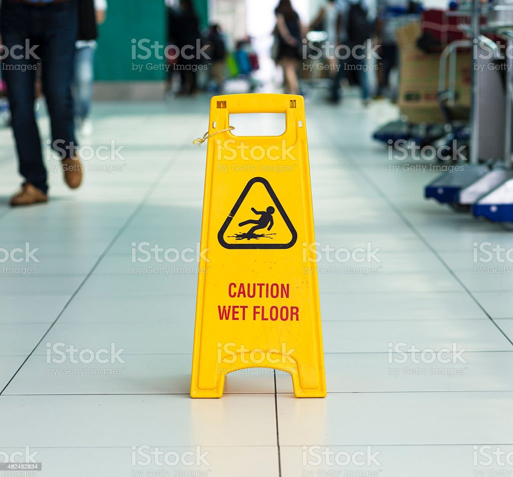 Yellow sign that alerts for wet floor. stock photo