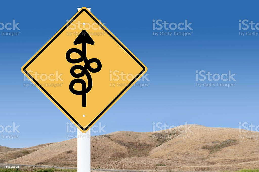 Yellow sign with confusing directions royalty-free stock photo