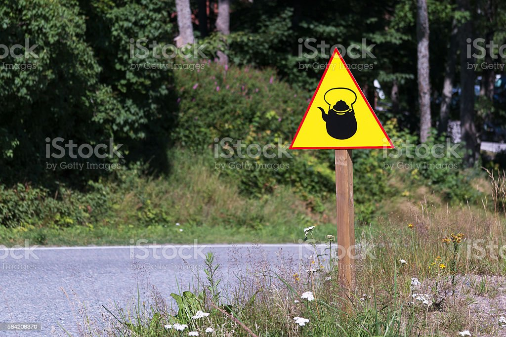 Yellow sign with kettle or teapot on the side of stock photo