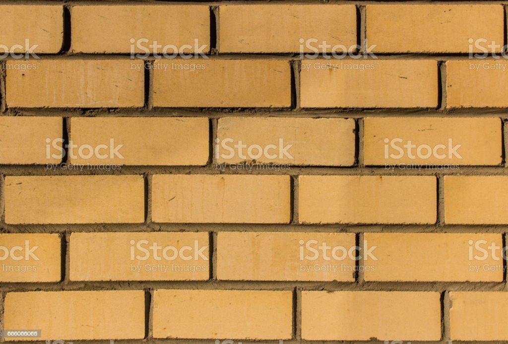 Yellow silicate brick wall closeup. stock photo
