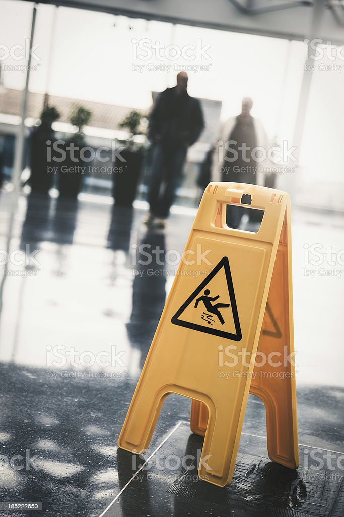 Yellow slippery sign on floor of office building stock photo