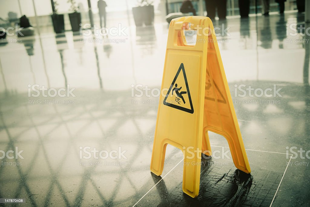 Yellow slippery warning sign stock photo