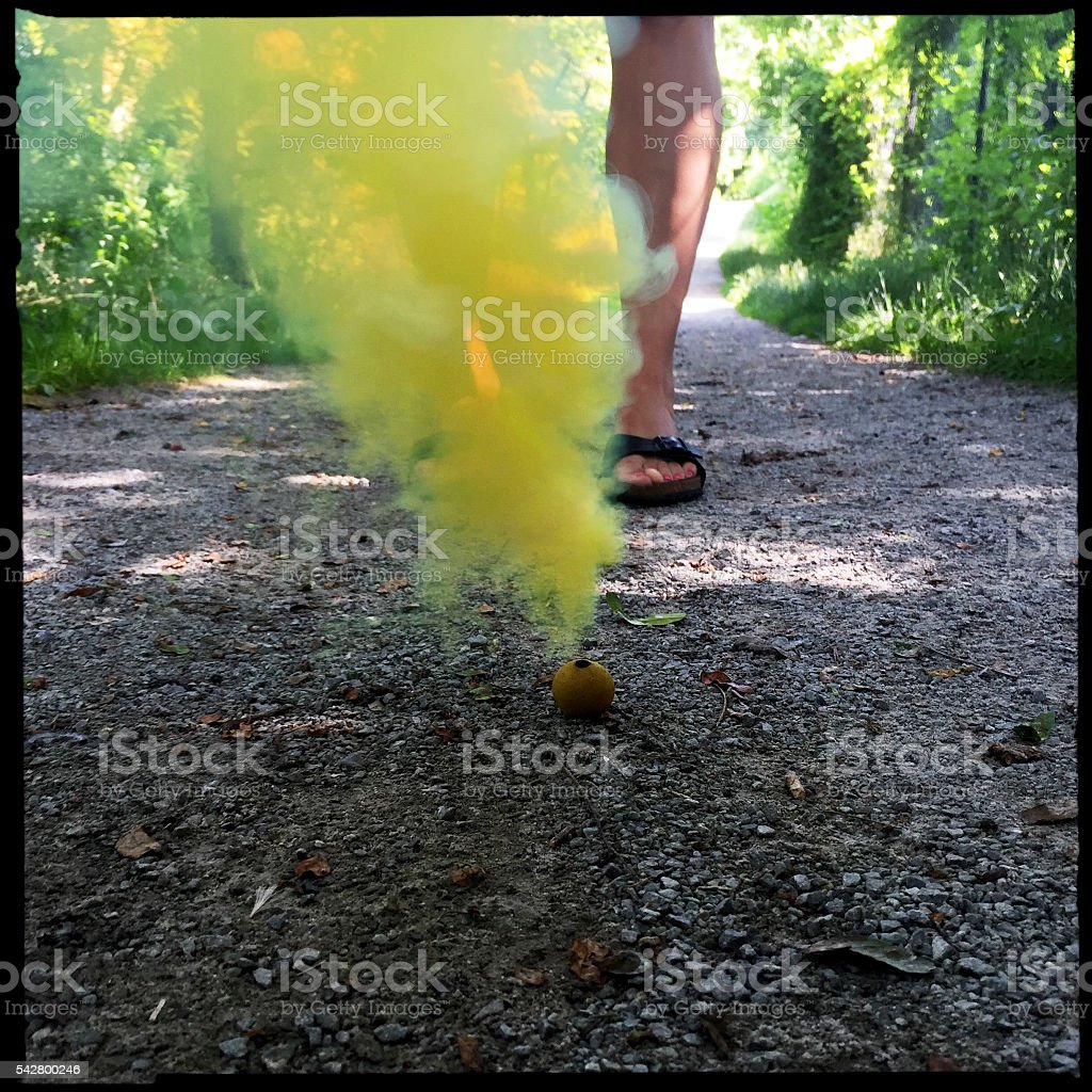 Yellow Smoke Bomb Concept stock photo