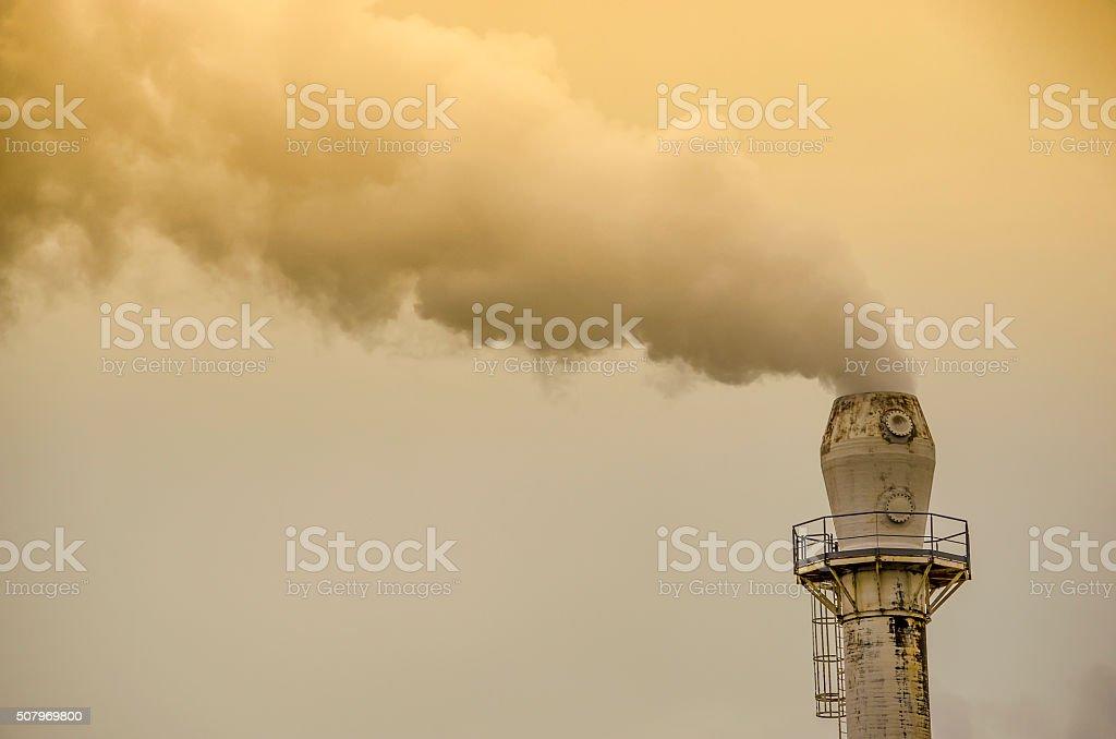 Yellow smoke from factory pipe stock photo