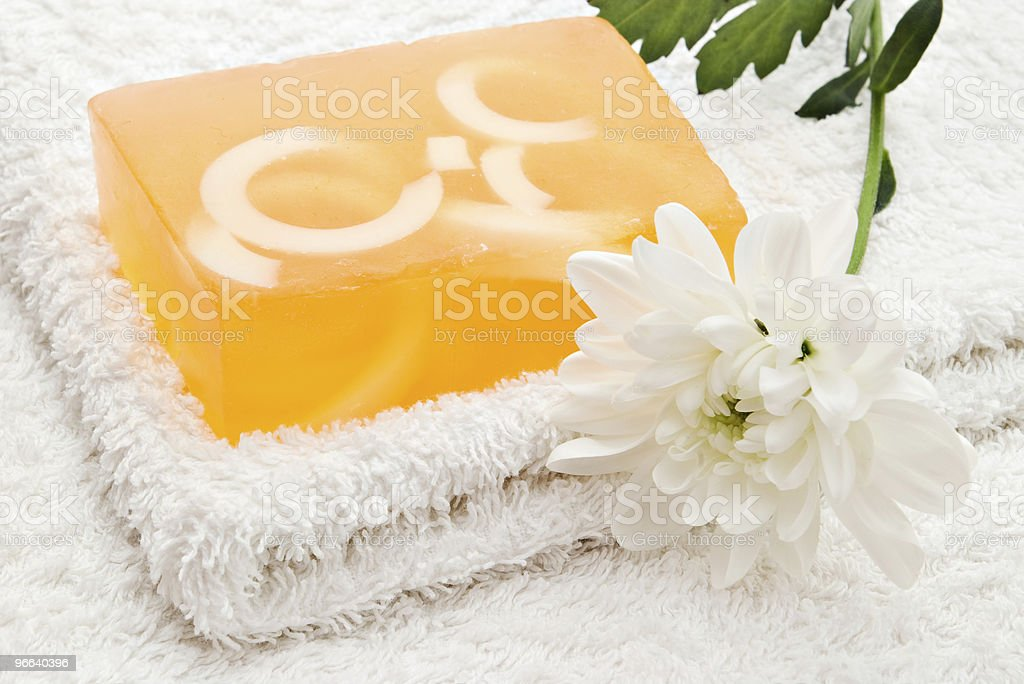 yellow soap on towel royalty-free stock photo