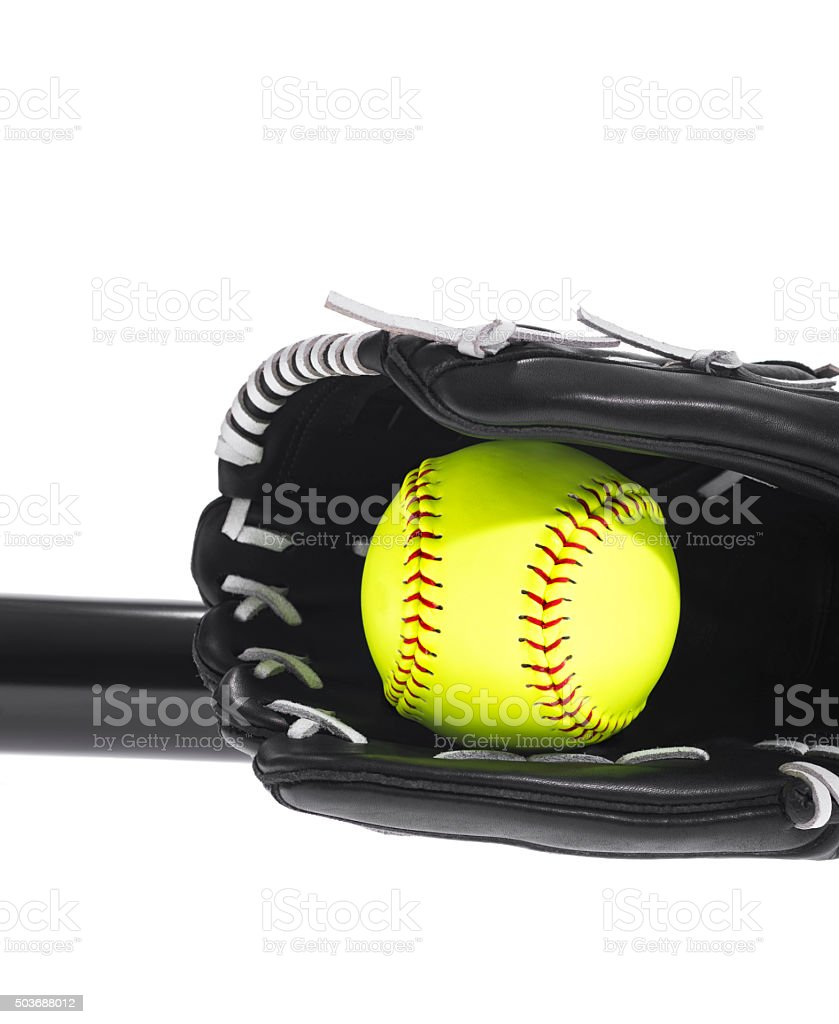 Yellow Softball in glove with bat on white background stock photo