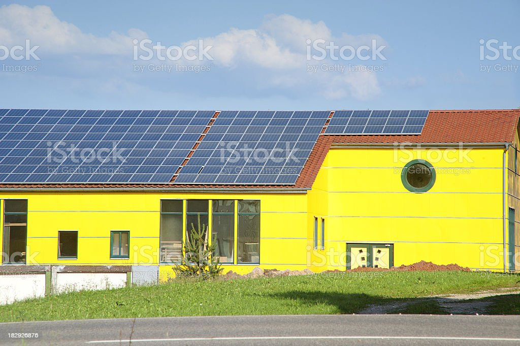 yellow solar-house on company roof stock photo