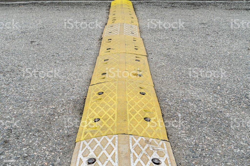 Yellow speed bump stock photo