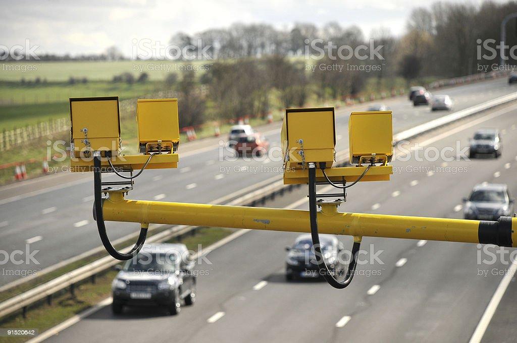 Yellow speed cameras above motorway stock photo