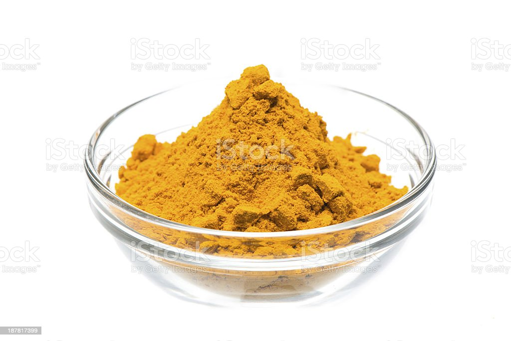 A yellow spice in a small glass prep bowl stock photo
