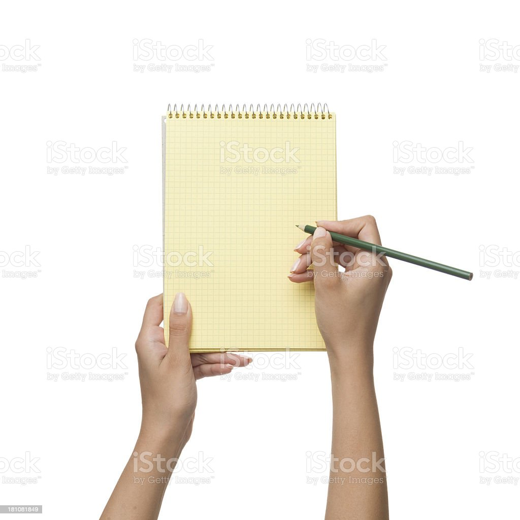 Yellow spiral notepad in woman hand on white background royalty-free stock photo