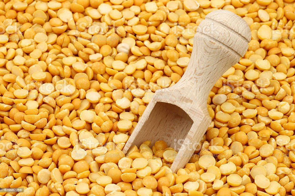 yellow split peas background stock photo