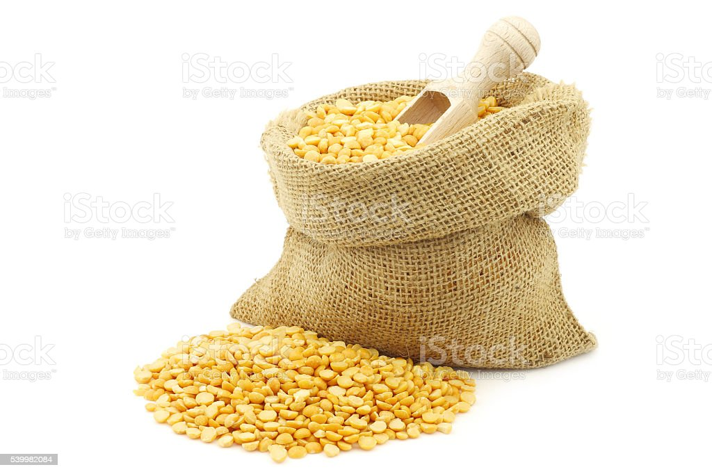 yellow split peas in a burlap bag stock photo