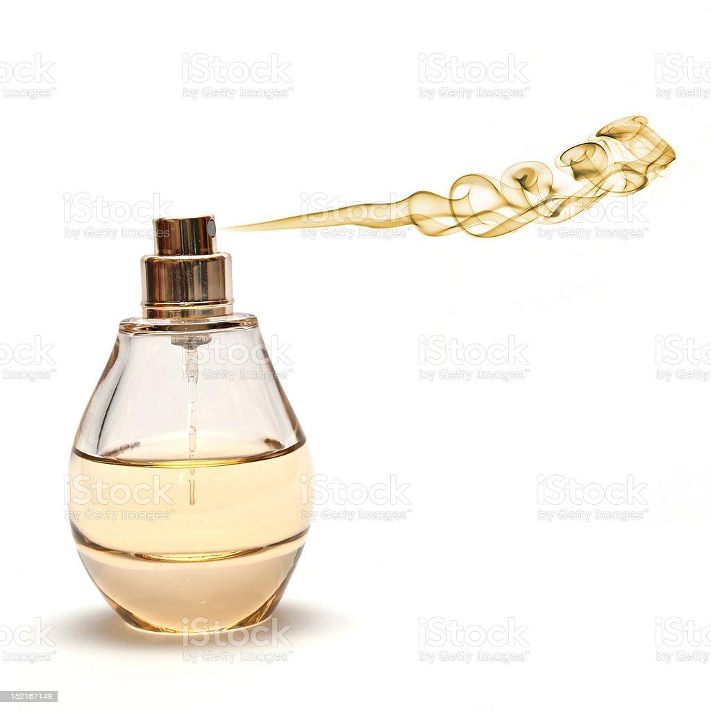 Yellow Spraying Parfume on White Background stock photo